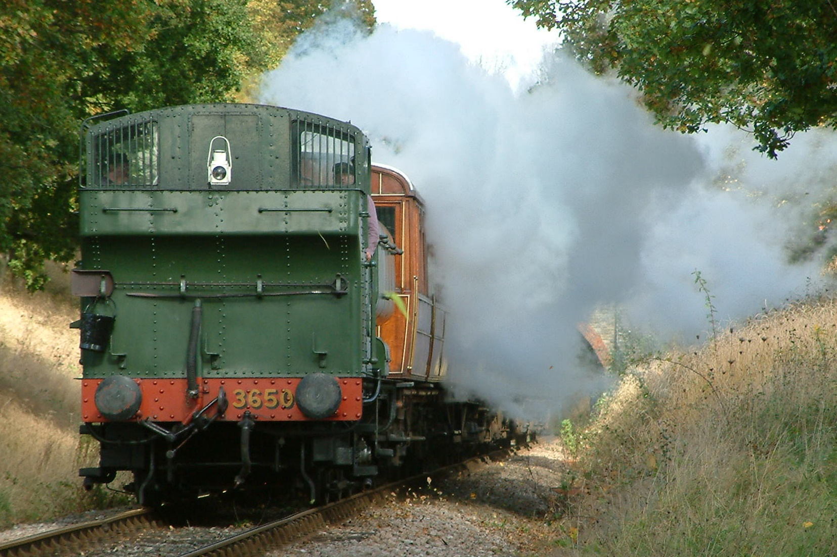 Great Western Railway Pannier Tank 3650 steaming backwards at Horsted House foot crossing