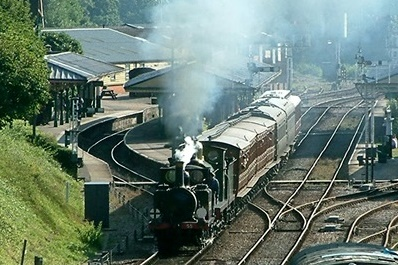 "LBSCR Stroudley Terrier, No.55 ""Stepney"" steaming north from Horsted Keynes Station seen from Leamland Bridge"